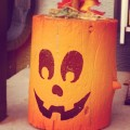 Painted wood stump Jack-o-lantern
